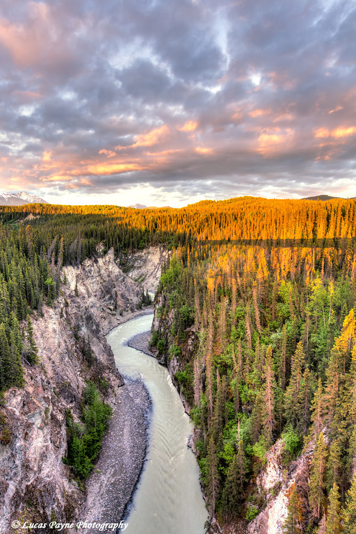 Scenic view of the Kuskulana River Canyon and Wrangell Mountains at sunset from the Kuskulana River Bridge on the McCarthy Road in Wrangell-St. Elias National Park and Preserve<br /> <br /> June 15, 2012