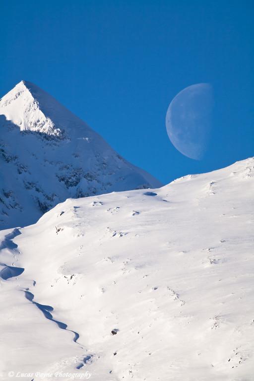 The Chugach Mountains and setting moon at Thompson Pass near Valdez, Alaska<br /> November 27, 2010