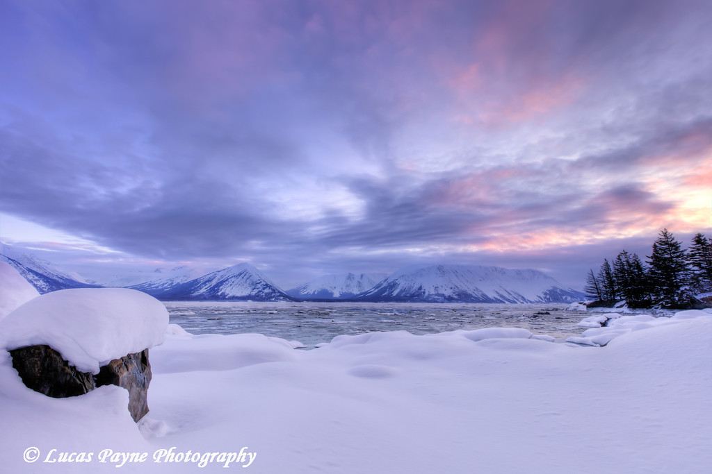 Scenic view of the snow covered shoreline of Turnagain Arm with the Chugach Mountains from the Hope Highway at sunrise.<br /> HDR<br /> March 22, 2012