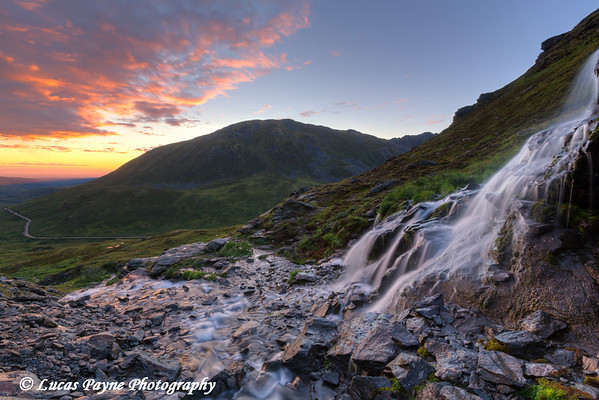 Scenic sunset view of a waterfall at Summit Lake State Recreation Site, Hatcher Pass.<br />  <br /> August 24, 2013