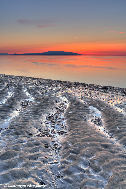 Sunset over Mt. Susitna (The Sleeping Lady) from the beach at Point Woronzof at low tide. Anchorage, Alaska<br /> <br /> May 08, 2013