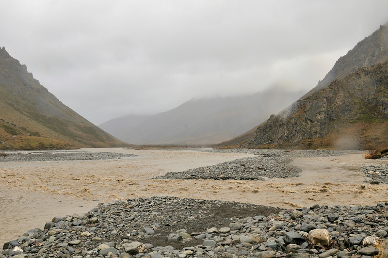 A small mountain stream (flowing from the right) and the Kongakut rivers were blown out from a heavy downpour of rain in the valley and snow in the mountains on day 4.