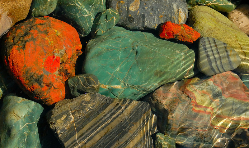 Stones brought down by glaciers from the Ahklun Mountains and tumbled in the streambed of the Nayagorum River - jade, jasper, conglomerate and banded gneiss.