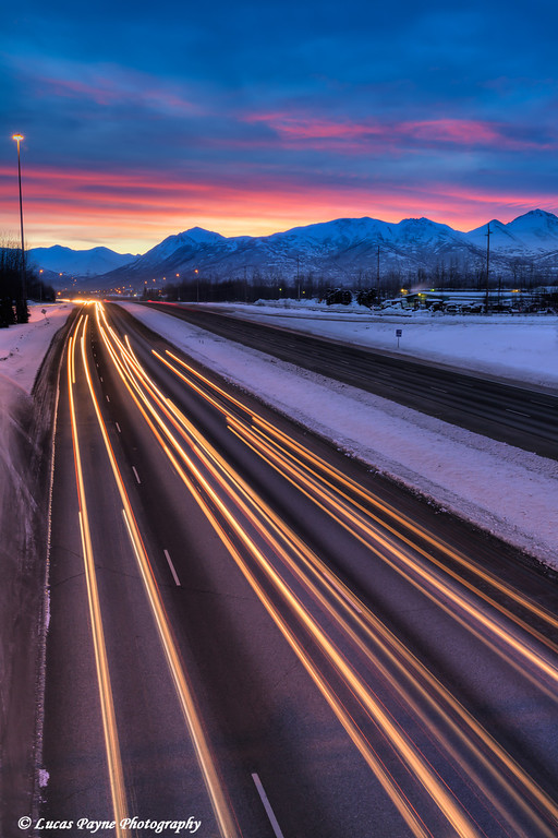 Morning commuter traffic on the Glenn Highway with the Chugach Mountains in the background.<br /> Anchorage, Alaska<br /> HDR<br /> February 24, 2011