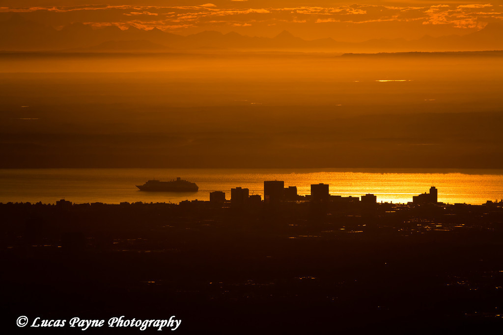 View of Downtown Anchorage and a Cruise Ship in Cook Inlet with the Alaska Range in the background at Sunset.<br /> June 17, 2011