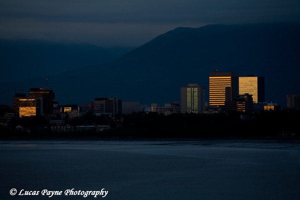 Sunset reflecting off buildings in downtown Anchorage, Alaska.<br /> June 5, 2009