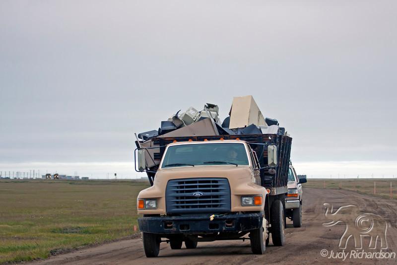 Truck carrying trash outside Barrow.