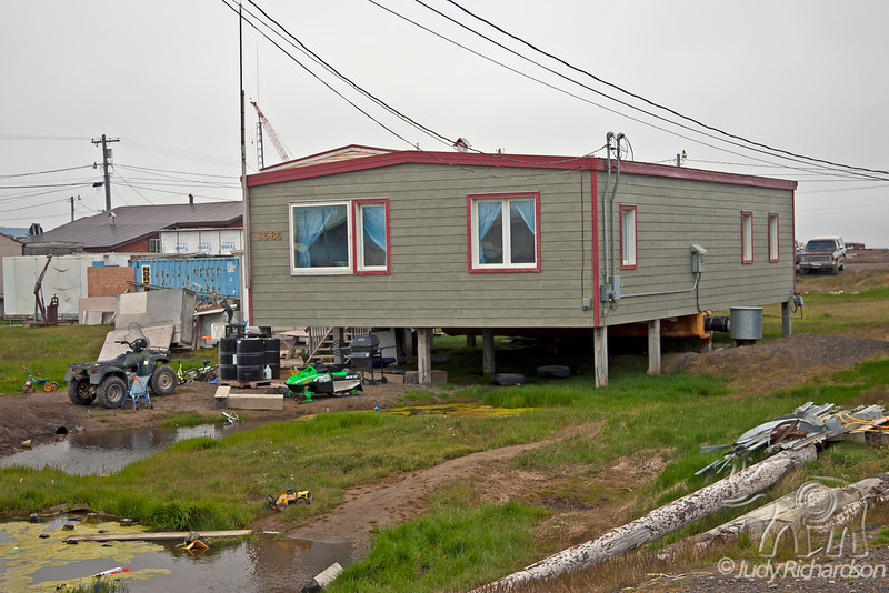 """Typical yard and house in """"nice"""" area of Barrow, Alaska"""