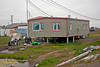 "Typical yard and house in ""nice"" area of Barrow, Alaska"