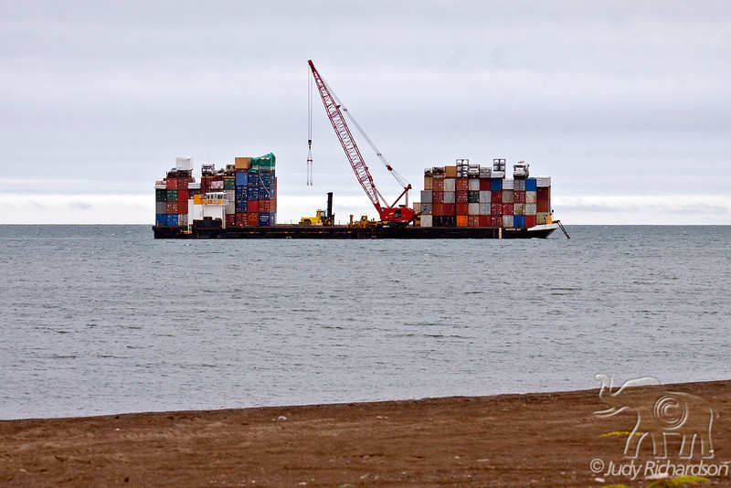 Containers waing in Artic Ocean to be off-loaded in Barrow, Alaska