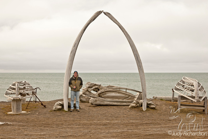 Whale bone arch with shells of whaleboats on each side~Alan by arch