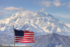 An American Flag flying over the Eielson Visitor Center with Denali (Mt. McKinley) in the background, Denali National Park and Preserve, Interior Alaska.<br /> <br /> August 02, 2013
