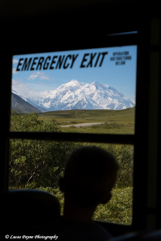 Silhouette of a young boy enjoying the view of Denali (Mt. McKinley) from inside a park shuttle bus at Denali National Park and Preserve, Interior Alaska.<br /> <br /> August 02, 2013