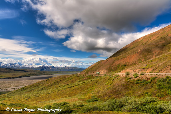 A park tour bus driving on the road through Denali National Park and Preserve with Mt. McKinley in the background.<br /> HDR<br /> August 08, 2011