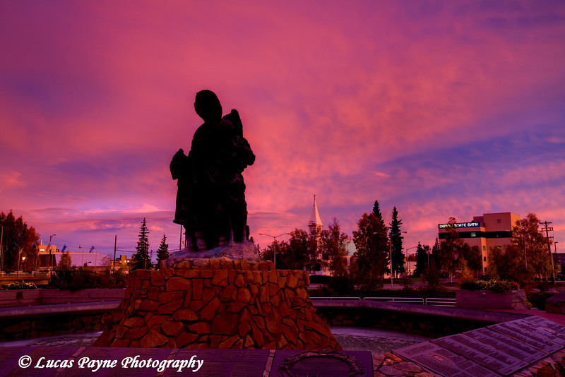 Alaskan Native statue at sunrise in downtown Fairbanks, Alaska.<br /> September 07, 2010