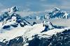 The peaks of Lituya Mountain and Mount Salisbury tower above the John Hopkins Glacier in Glacier Bay National Park, Alaska, USA, America.