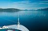 A cruise ship sailing into the calm waters of Glacier Bay, Alaska, USA.