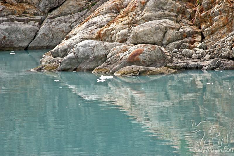Colorful rocks reflected in glacial water~Glacier Bay