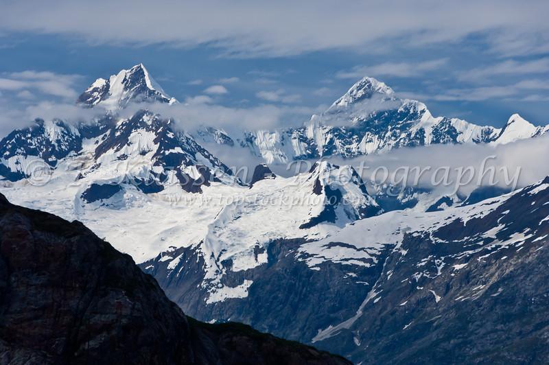 Glacier Bay and its snow covered peaks of Lituya Mountain and Mount Salisbury in Glacier Bay National Park, Alaska, USA, America.