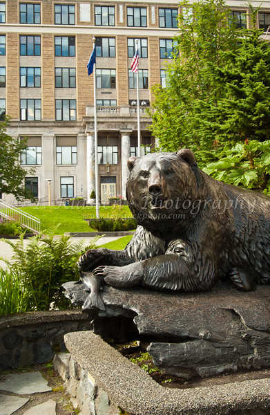 The bear and fish monument near the State Capitol building in Juneau, Alaska, USA, America.
