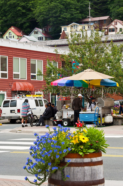Flowers with street food for sale in Juneau, Alaska, USA, America.