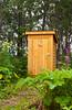 An outhouse in the bush near Ninilichik, Alaska, USA, America.
