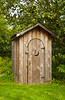 An outhouse with moon door in the town of Homer, on the Kenai peninsula, Alaska, USA, America.