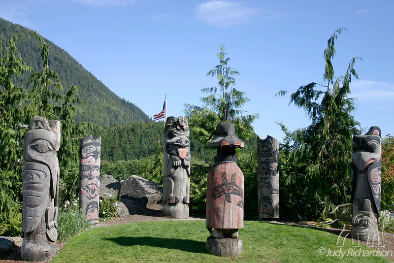 Totem poles on hill over-looking Ketchikan