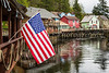 Creek Street and the American flag in Ketchikan, Alaska, USA.