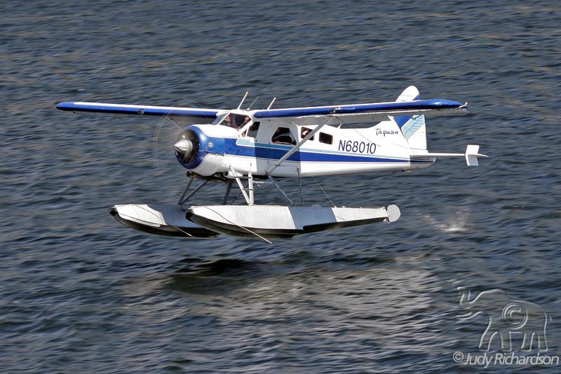 Float plane landing at Ketchikan dock