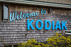 A Welcome to Kodiak sign at the port in Kodiak, Alaska, USA.