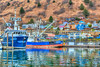Colorful fishing boats with reflections in the marina at Kodiak, Alaska, USA.