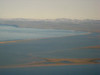 Air view over the lagoon to the mountaisn
