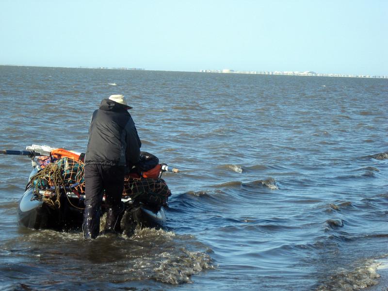 Pushing the raft along the beach, toward Pt. Hope
