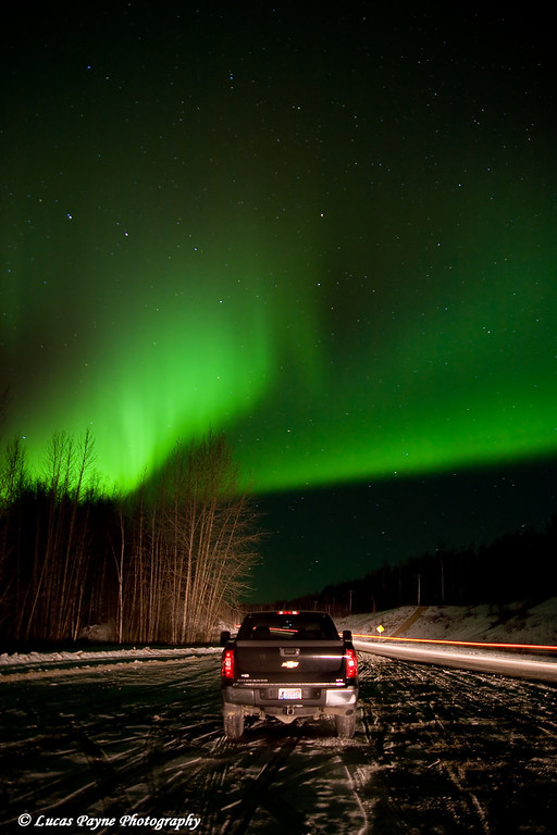The aurora dancing over my truck along the Parks Highway in Alaska. <br /> (The streak of lights on the right was from a passing car during my exposure. It also helped to light up my truck and the surrounding area.)<br /> October 28, 2008