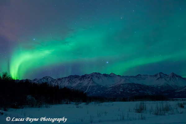 Aurora Borealis (Northern Lights) over the Knik River Valley and the Chugach Mountains<br /> Alaska<br /> January 24, 2012