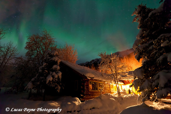 Aurora Borealis (Northern Lights) over the Eagle River Nature Center and Chugach Mountains, Alaska<br /> January 25, 2012