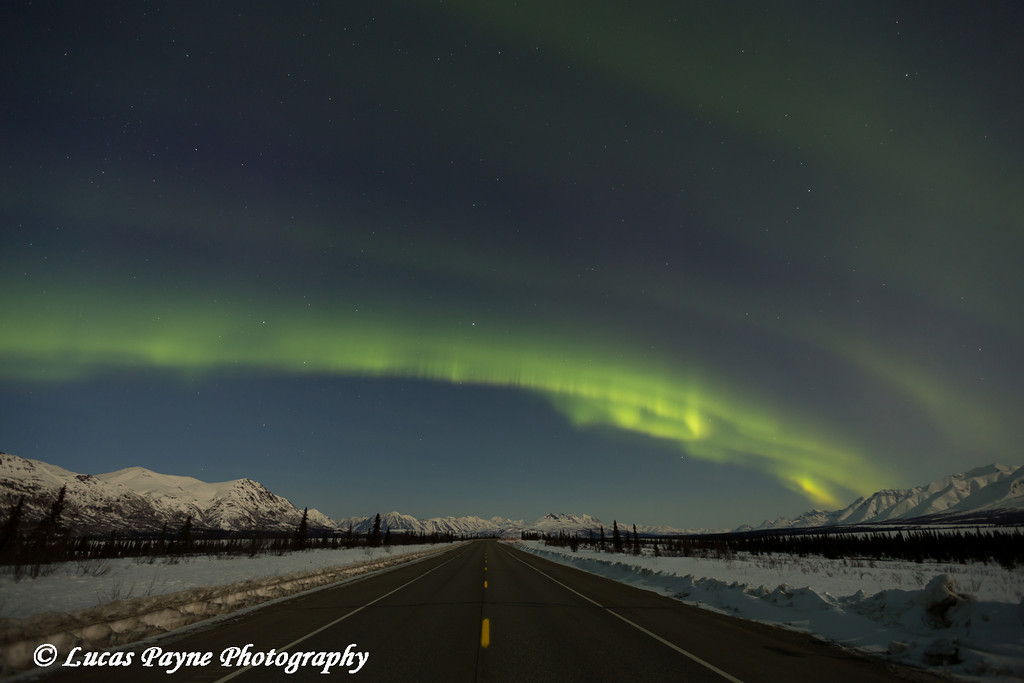 View of the Aurora Borealis (Northern Lights) dancing above the Alaska Range and Parks Highway at Broad Pass, Interior Alaska.<br /> <br /> April 11, 2014
