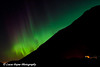 Aurora Borealis (Northern Lights) over the Chugach Mountains and Begich, Boggs Visitor Center in Chugach National Forest<br /> October 04, 2011