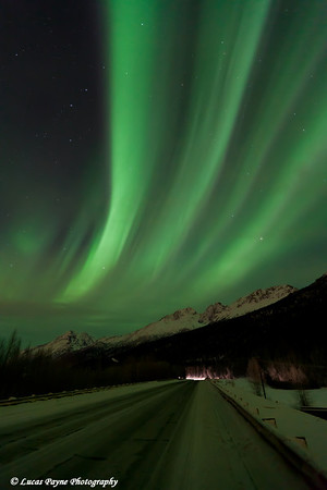Aurora Borealis (Northern Lights) over the Old Glenn Highway and Chugach Mountains in the Matanuska-Susitna Valley, Alaska<br /> January 24, 2012