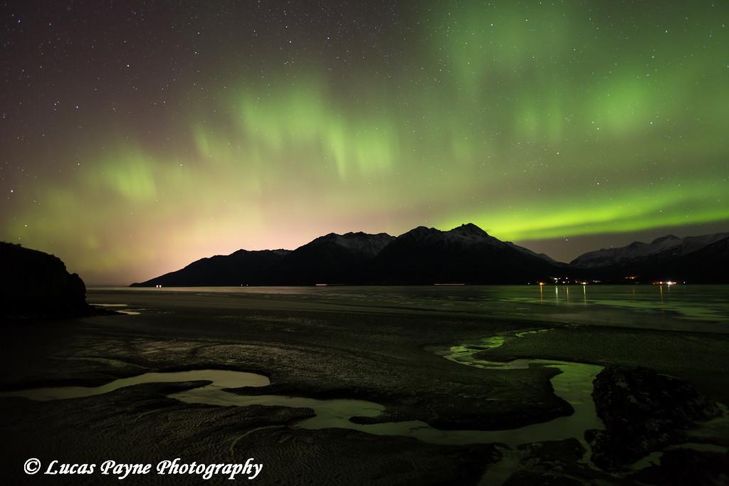 View of the Aurora Borealis (Northern Lights) dancing above the Chugach Mountains and Turnagain Arm, Kenai Peninsula, Alaska.<br /> <br /> January 22, 2015
