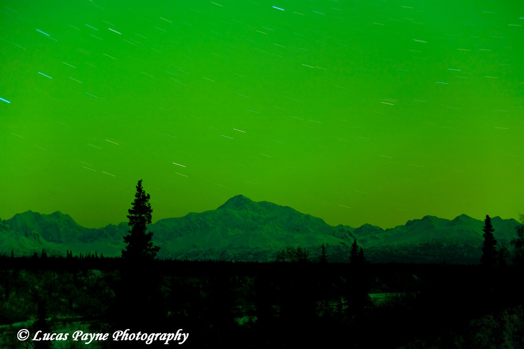 The green glow of the Aurora Borealis lights up the sky over Denali (Mt. Mckinley) in Alaska.<br /> October 28, 2008