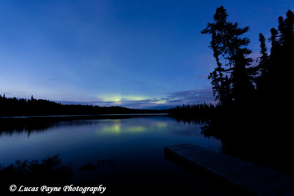 Faint glow of the Aurora Borealis (Northern Lights) over South Rolly Lake at Nancy Lake State Recreation Area<br /> September 09, 2011