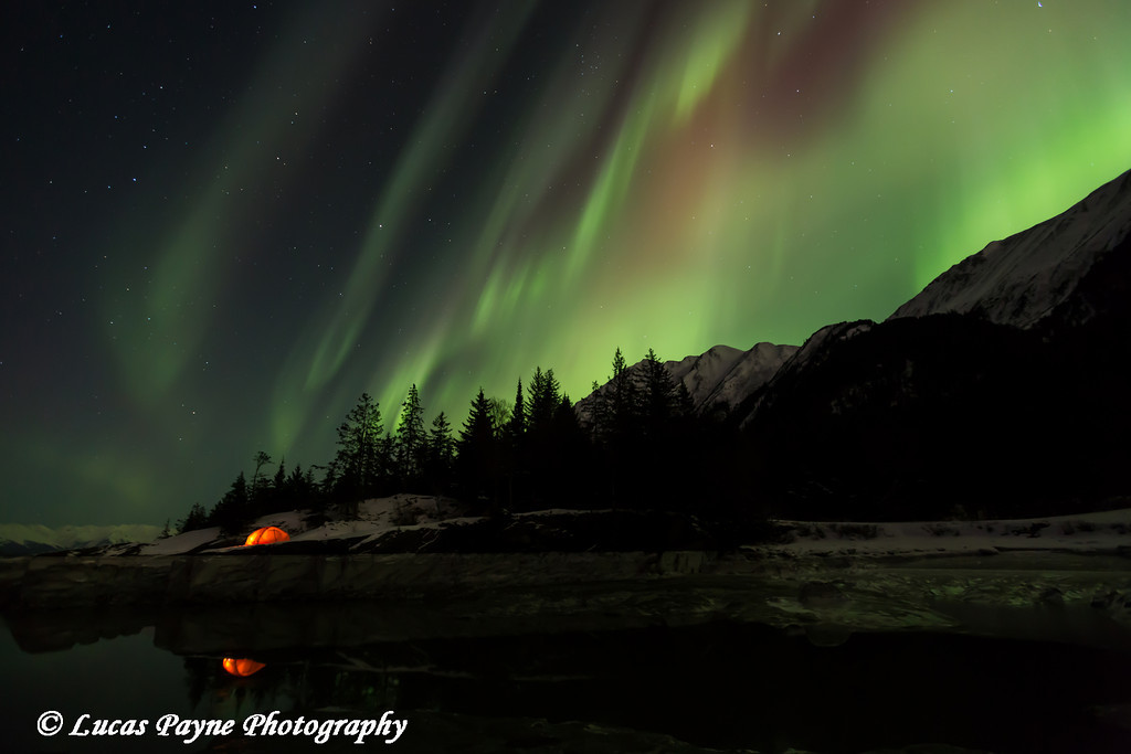 Northern Lights dancing above the Kenai Mountains and a backpacking tent reflected in Turnagain Arm, Kenai Peninsula, Alaska<br /> <br /> March 17, 2013