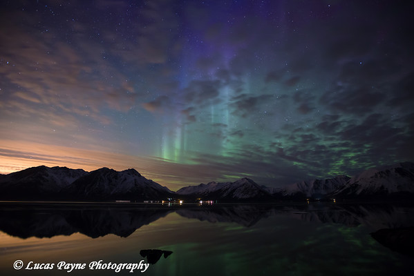 The Aurora Borealis (Northern Lights) over the Chugach Mountains reflected in the calm waters of Turnagain Arm<br /> April 13, 2012