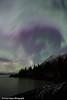 View of the Aurora Borealis (Northern Lights) dancing above the Kenai Mountains and Turnagain Arm, Kenai Peninsula, Southcentral, Alaska.<br /> <br /> November 04, 2015