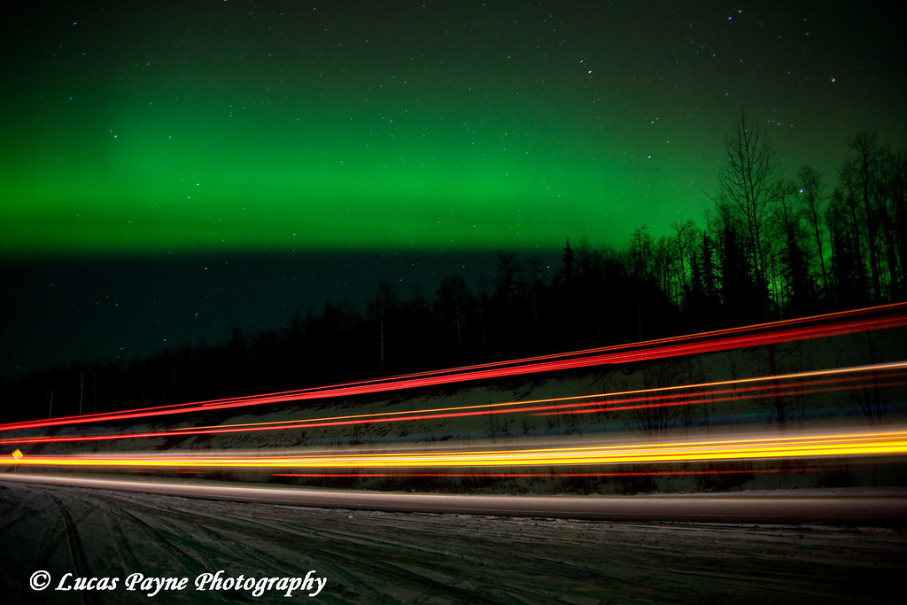 The aurora borealis over the Parks Highway in Alaska. <br /> (The streak of lights was from a passing semi during my exposure.)<br /> October 28, 2008