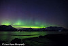 The Aurora Borealis (Northern Lights) dancing above the Chugach Mountains and reflecting on the waters of Turnagain Arm<br /> April 14, 2012