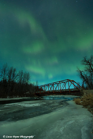 View of green  Northern Lights above Peters Creek and the Dollar Creek Bridge, Petersville Road, Southcentral Alaska<br /> <br /> <br /> November 01, 2012