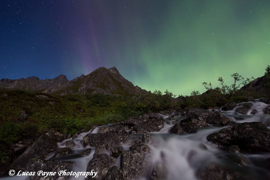 Aurora Borealis (Northern Lights) dancing above Archangel Creek and the Talkeetna Mountains in Archangel Valley, Hatcher Pass, Alaska<br /> <br /> August 24, 2013